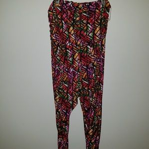 Bold, multicolor romper gently worn